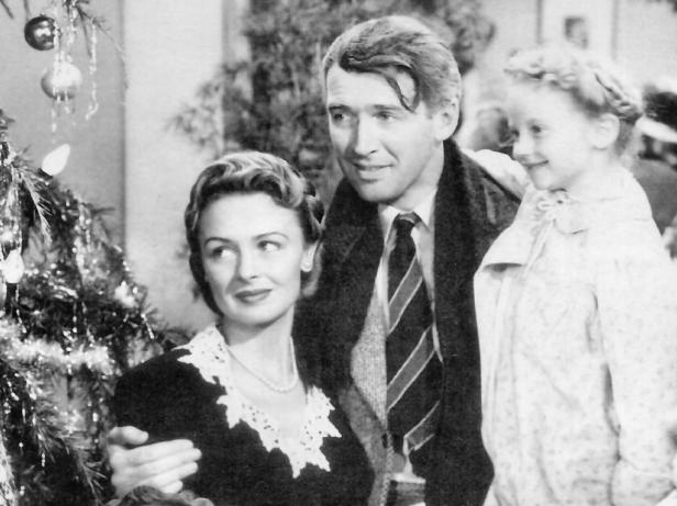 James Stewart as George Bailey, with his wife and daughter.
