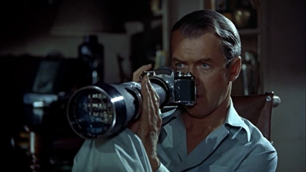 James Stewart stalking his neighbors in Rear Window.